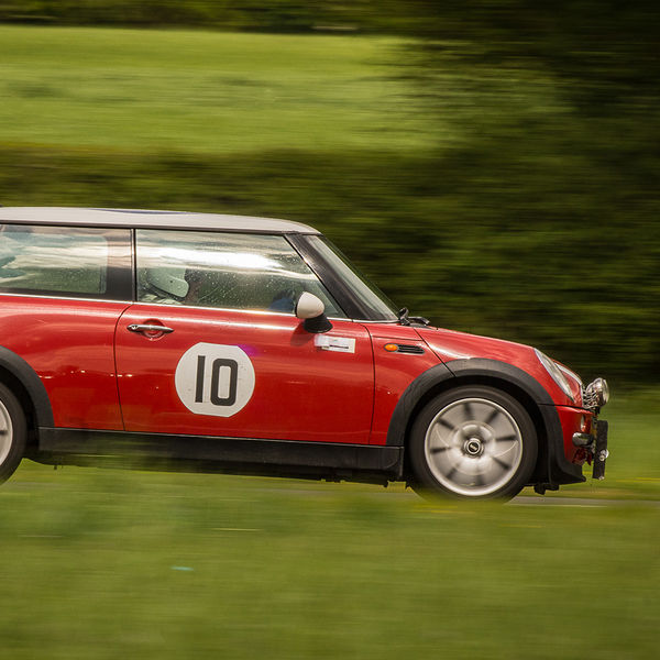 red mini at speed on sprint track