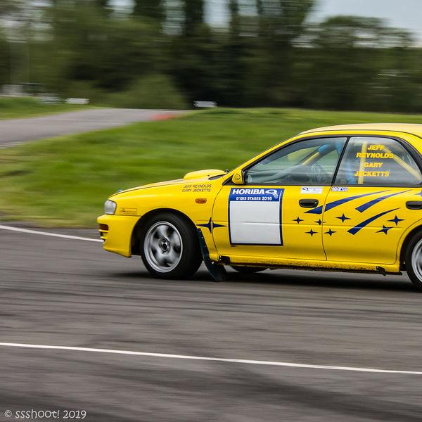 Yellow Subaru Impreza at speed on Curborough Sprint Course