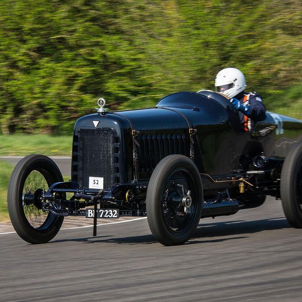 dark Blue hudson vintage racing car at speed on curborough sprint course