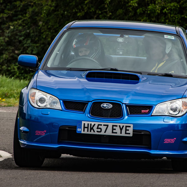 Blue Subaru Impreza Sti at speed on Curborough Sprint Course
