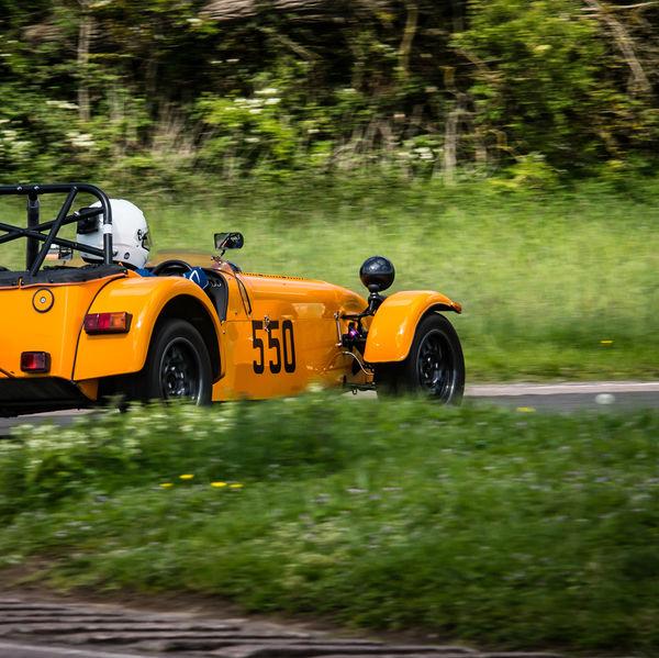 Orange caterham 7 exiting flagpole corner at curborough sprint course