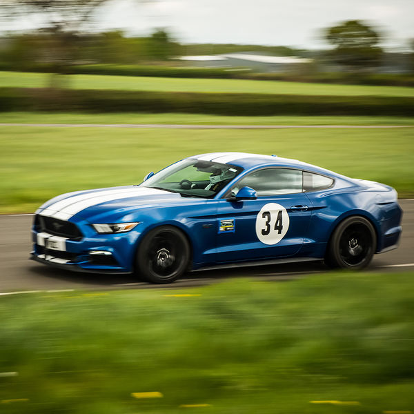 blue ford mustang at speed on curborough shenstone straight