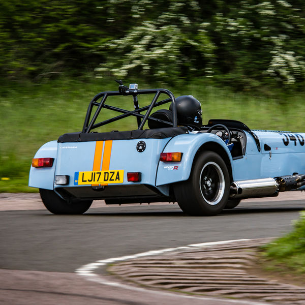 Caterham 7 in gulf racing colours exiting flagpole corner at curborough sprint course