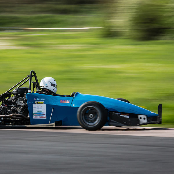 motorcycle engined race car shot at speed with panning photography