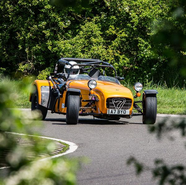 orange caterham 7 rounding the fradley hairpin corner at curborough sprint track