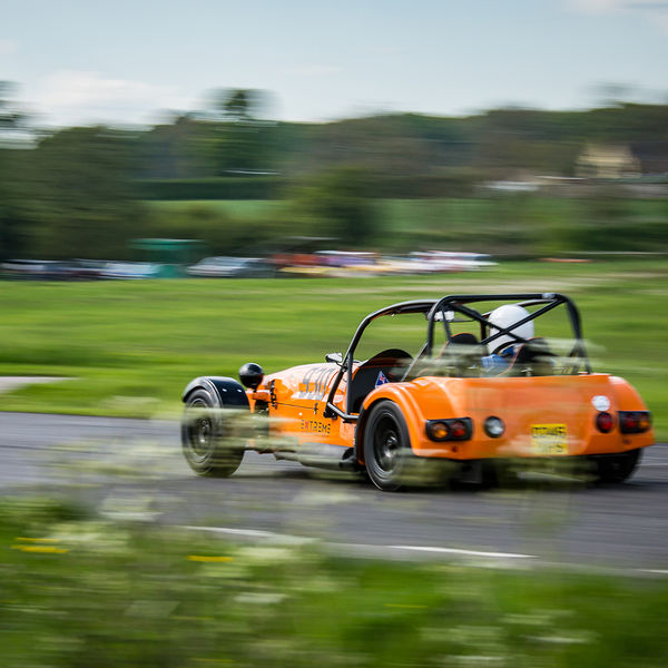 Orange Lotus 7 Caterham Westfield at finish line on Curborough Sprint Course