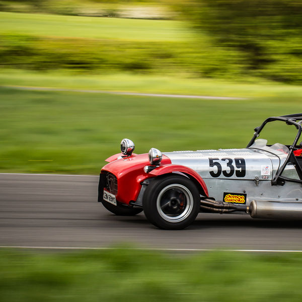 Red and silver Lotus 7 Caterham Westfield at speed on Curborough Sprint Course