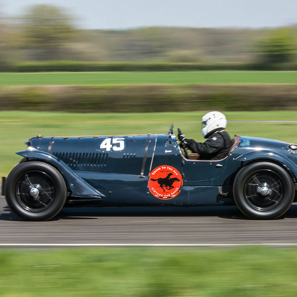 teal coloured vintage racing car at speed on curborough sprint course