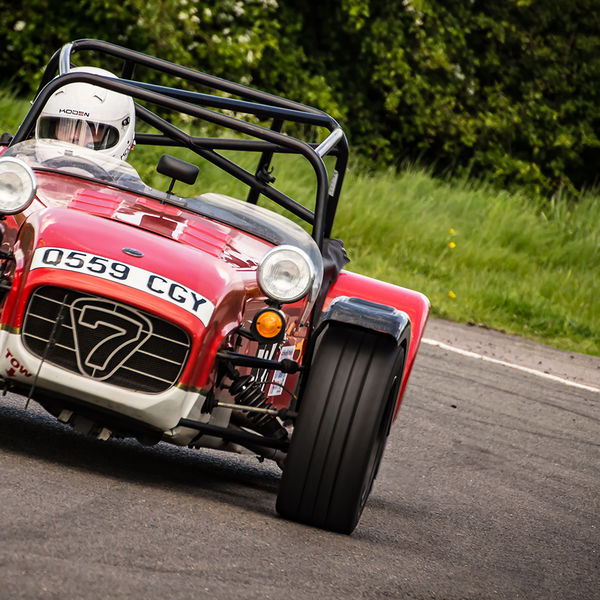 red caterham 7 rounding the fradley hairpin corner at curborough sprint track