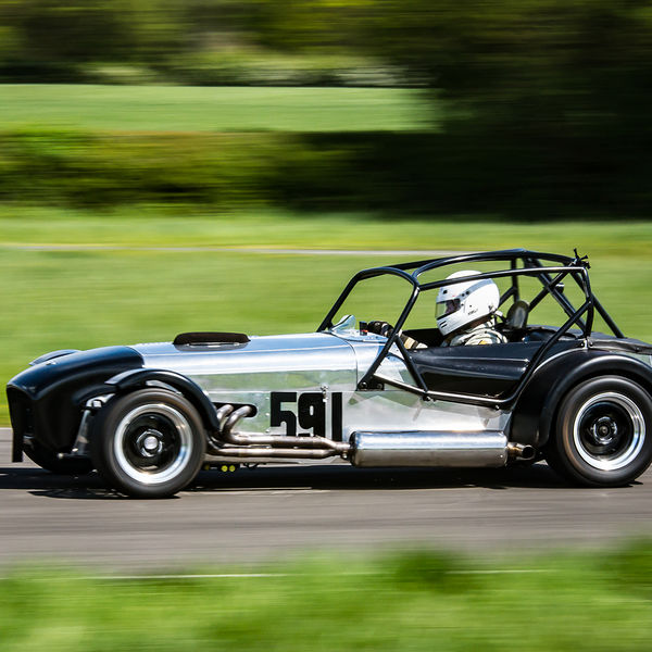 Silver Caterham 7 at speed along the Curborough sprint course shenstone straight