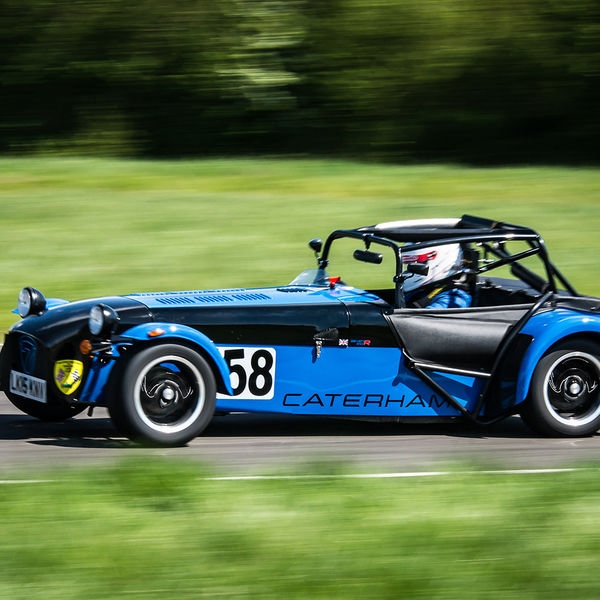Blue Caterham 7 at speed along the Curborough sprint course shenstone straight