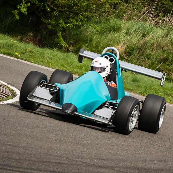 pale blue motorcycle engined race car rounding curborough sprint track fradley hairpin corner