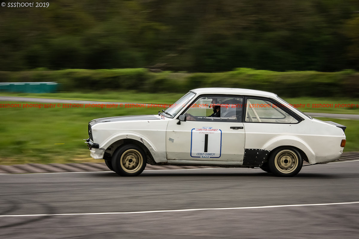 White ford escort mark 2 at speed on Curborough Sprint Course with opposite lock