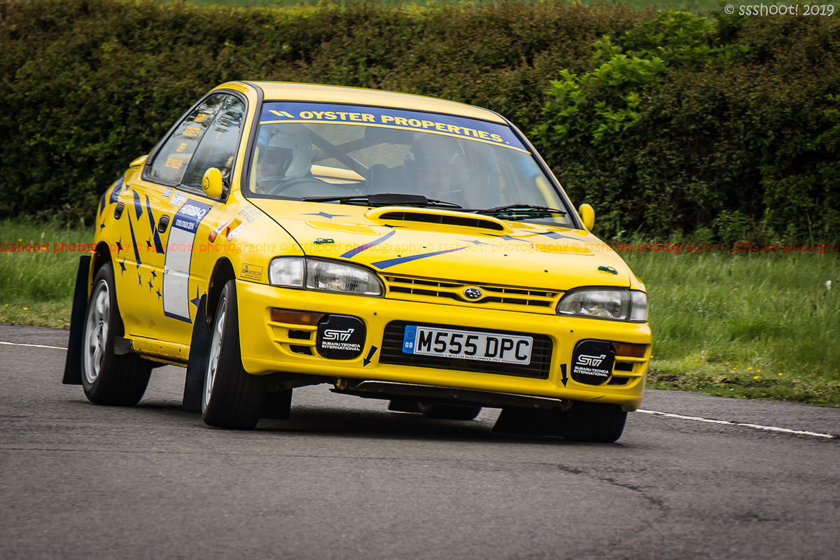 Yellow Subaru Impreza turning into the hairpin at speed on Curborough Sprint Course