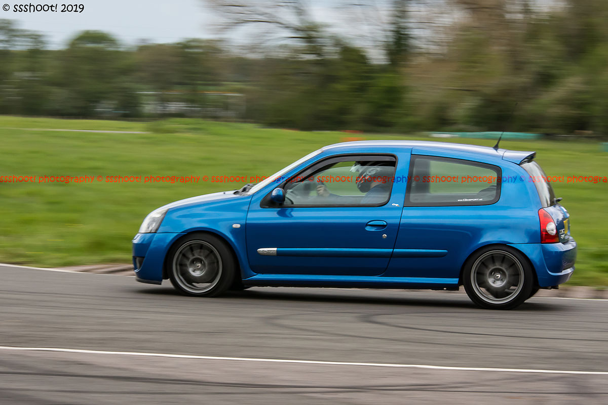 Blue Renault Clio taking the hairpin at speed on Curborough Sprint Course
