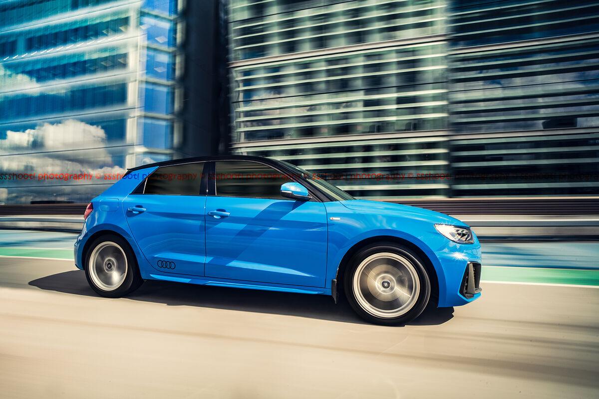 blue audi a1 shot with automotive camera rig in birmingham city centre