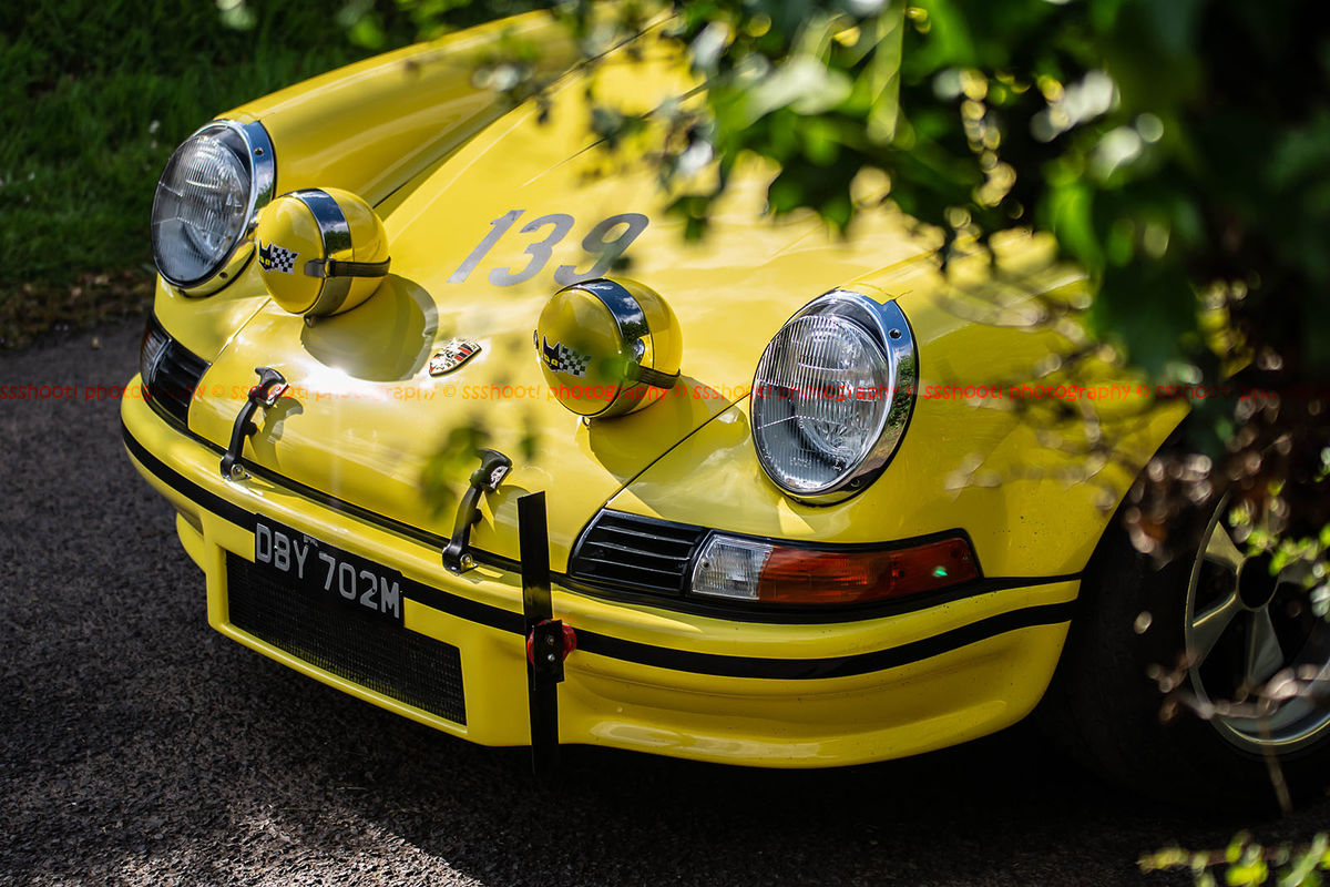 yellow classic porsche 911 racing car waiting in the lane at shelsley walsh hill climb