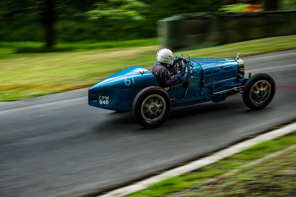 light blue type 35 vintage bugatti taking on the famous prescott hill climb at the la vie en bleu event