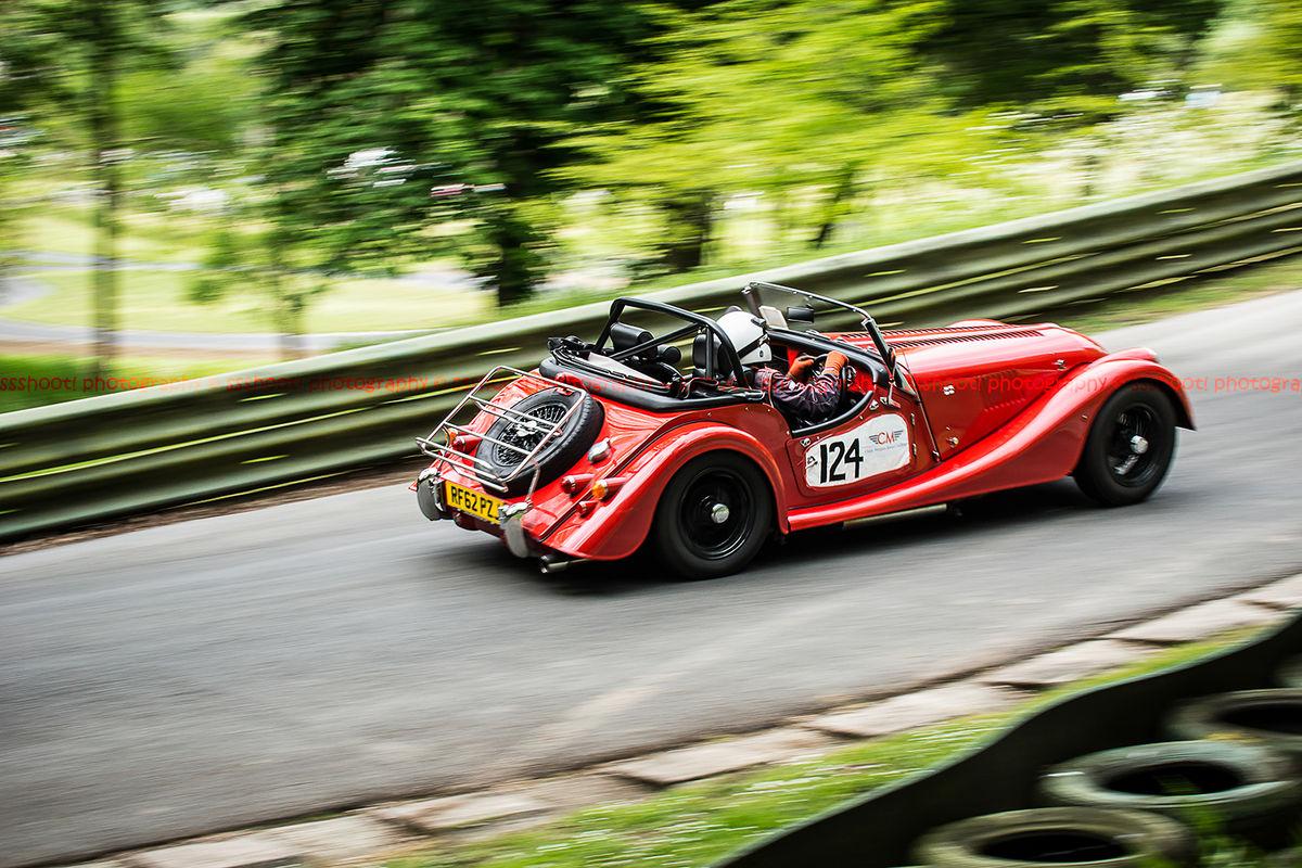 red morgan sports car at speed on prescott hill climb during the la vie en bleu event 2019