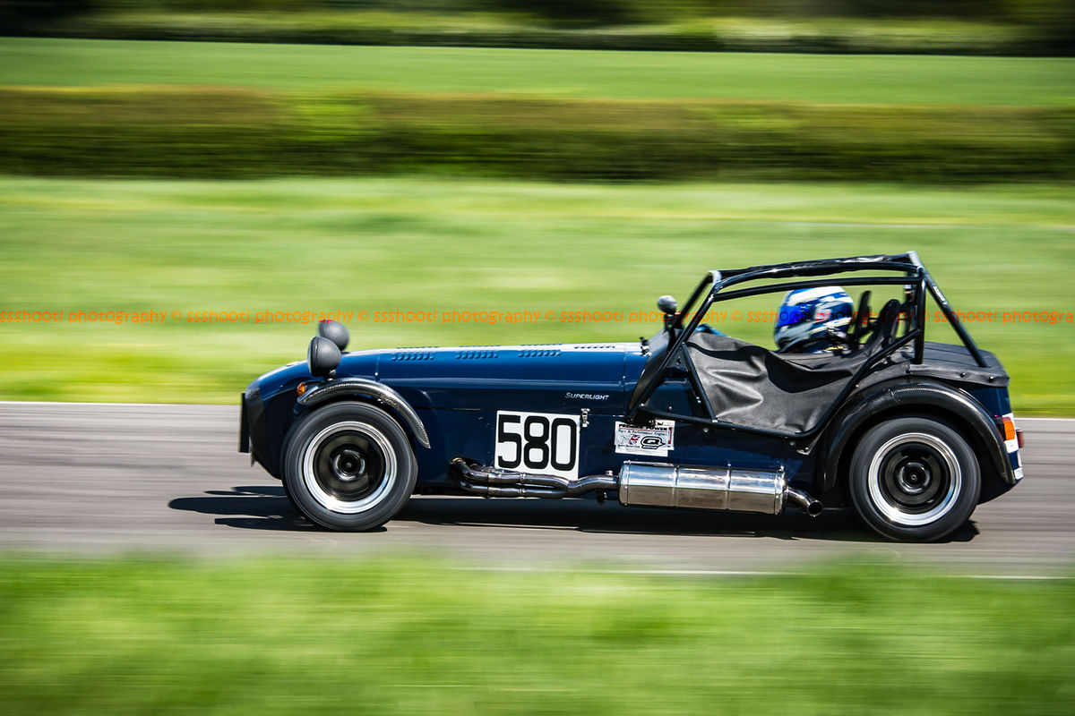 Dark Blue Caterham 7 at speed along the Curborough sprint course shenstone straight