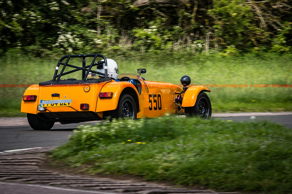 Orange caterham 7 exiting flagpole corner at curborough sprint course