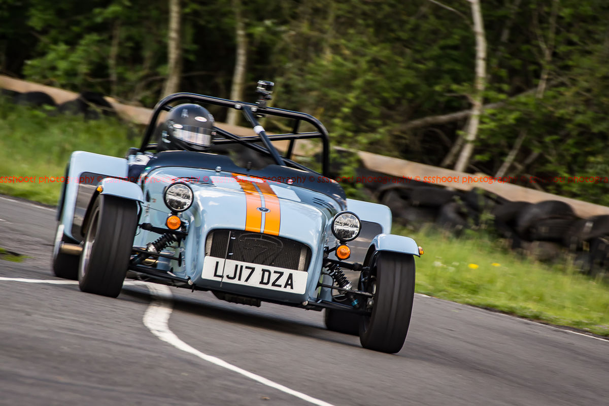 Gulf racing caterham 7 at speed through curborough sprint course mole hill corner