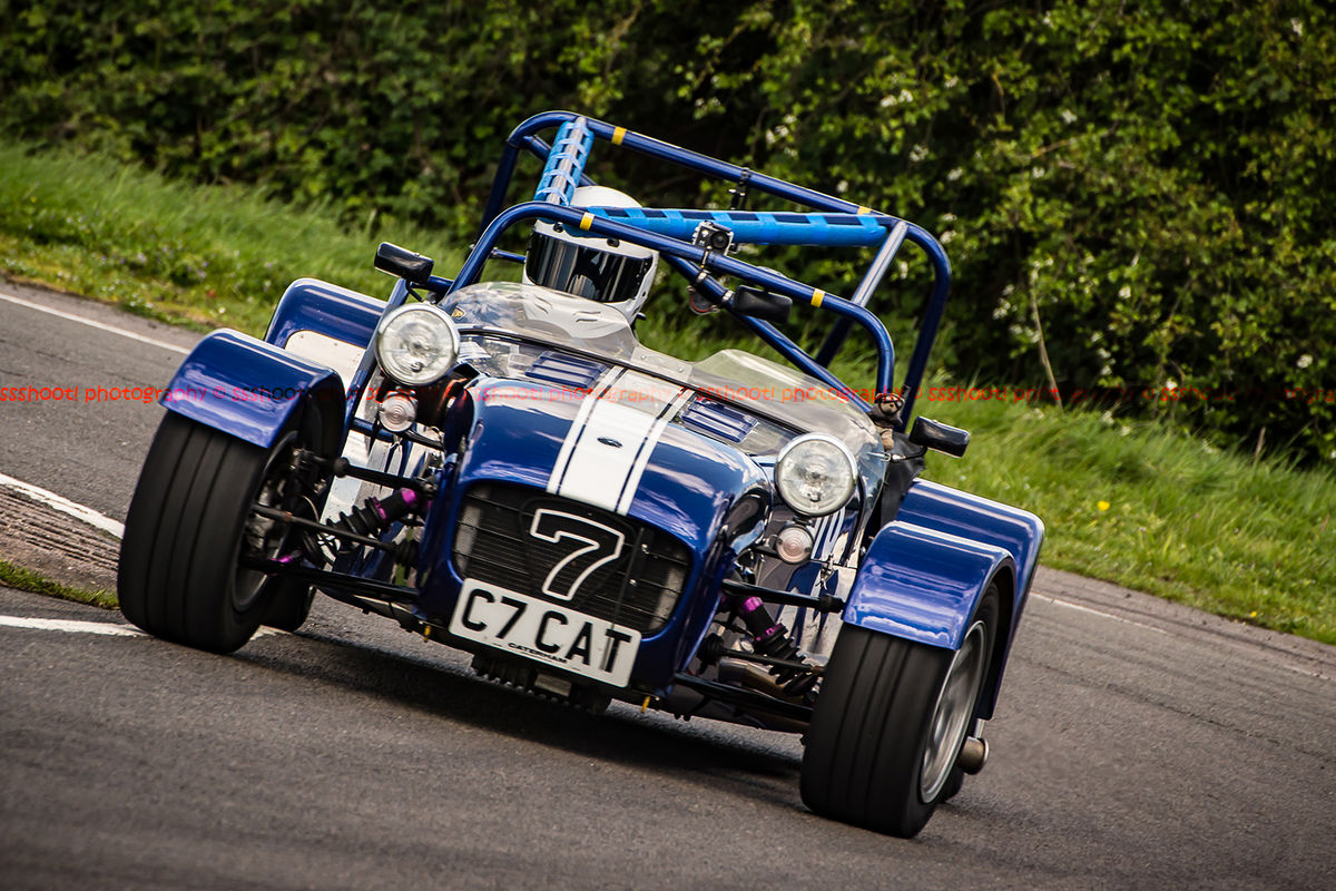blue caterham 7 rounding the fradley hairpin corner at curborough sprint track