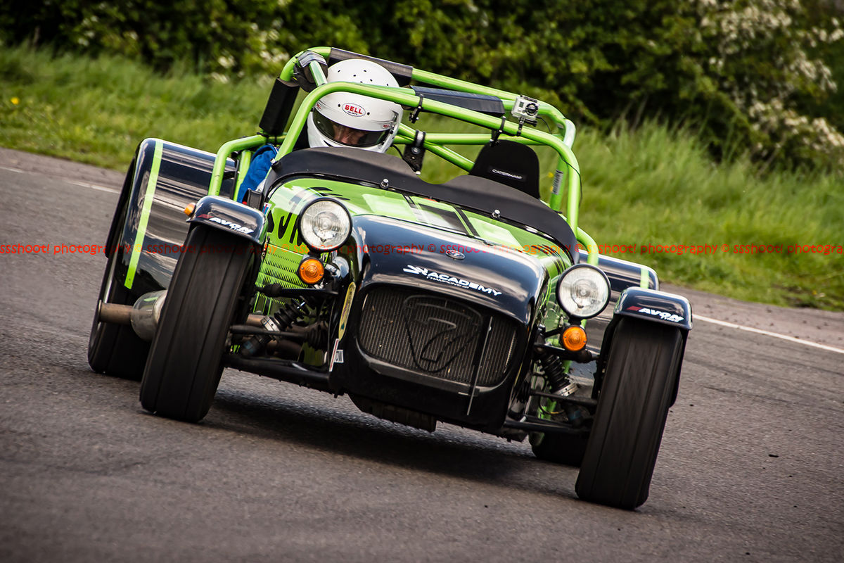 lime green caterham 7 rounding the fradley hairpin corner at curborough sprint track