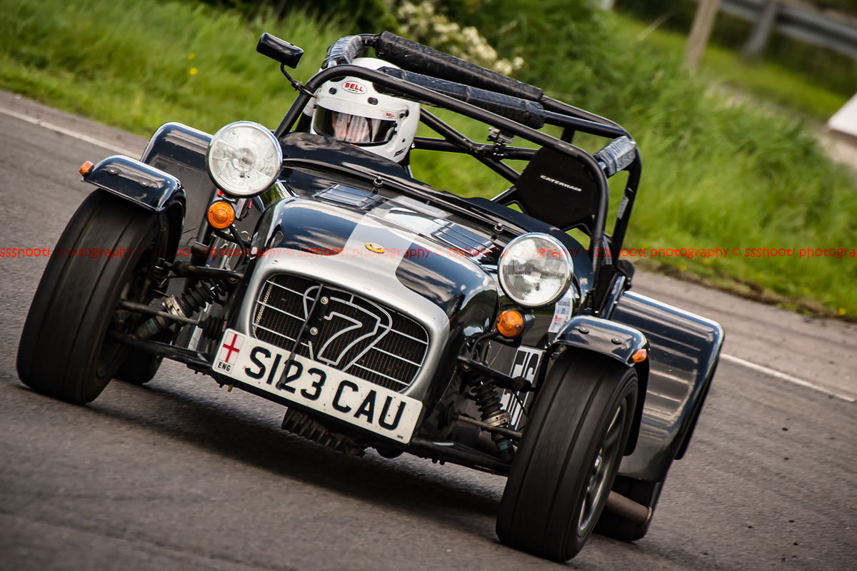 black and silver caterham 7 rounding the fradley hairpin corner at curborough sprint track