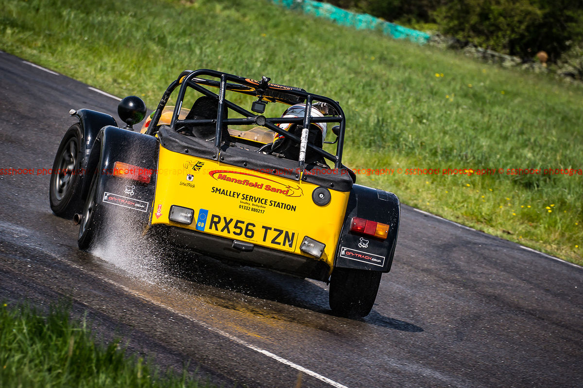 Yellow Lotus 7 Caterham Westfield opposite lock in rain at Curborough Sprint Course