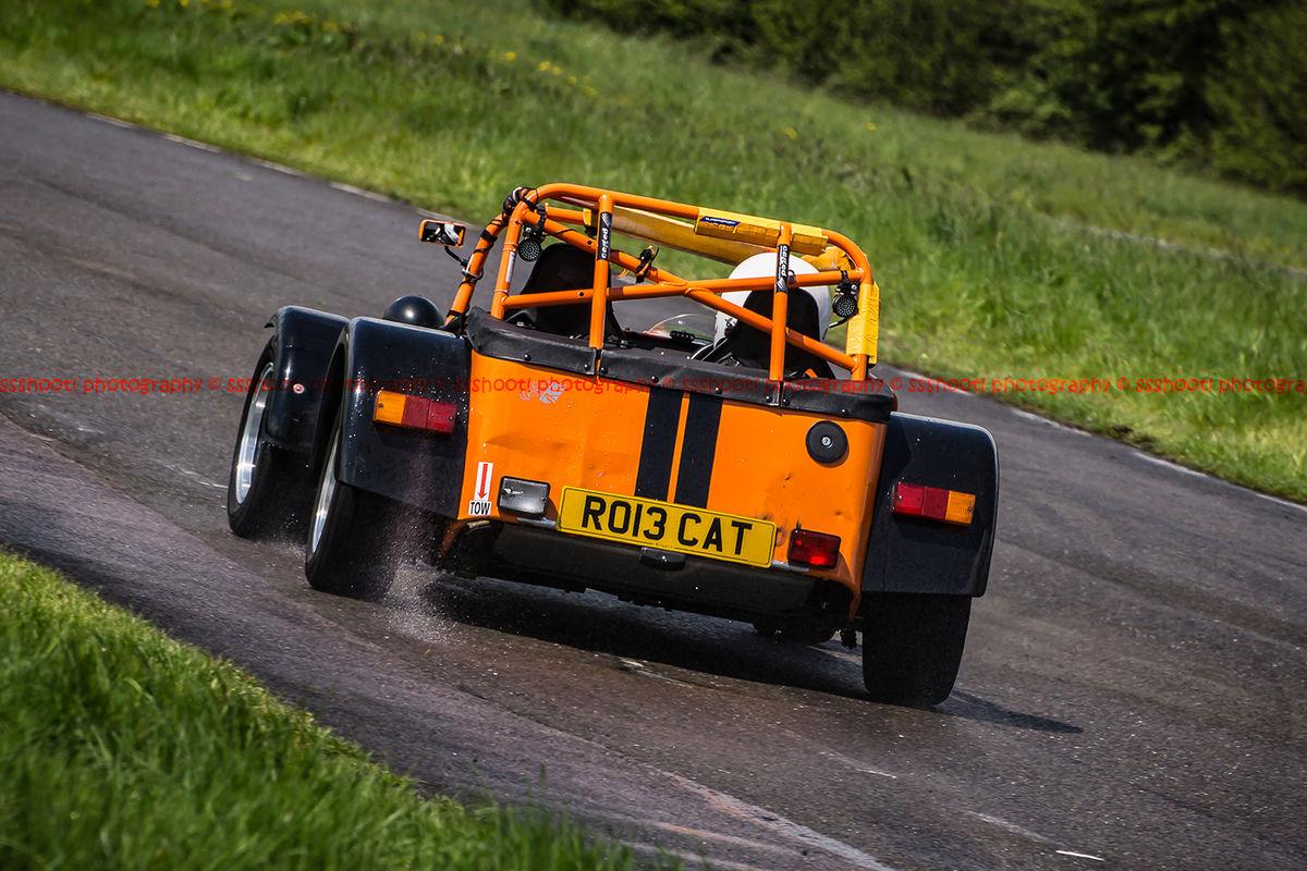 Orange Lotus 7 Caterham Westfield opposite lock in rain at Curborough Sprint Course