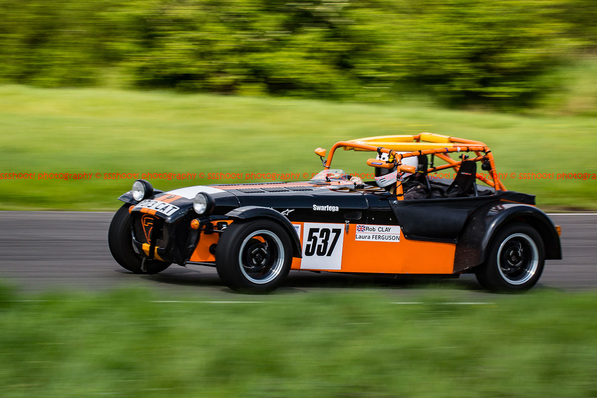Orange and black Lotus 7 Caterham Westfield at speed on Curborough Sprint Course