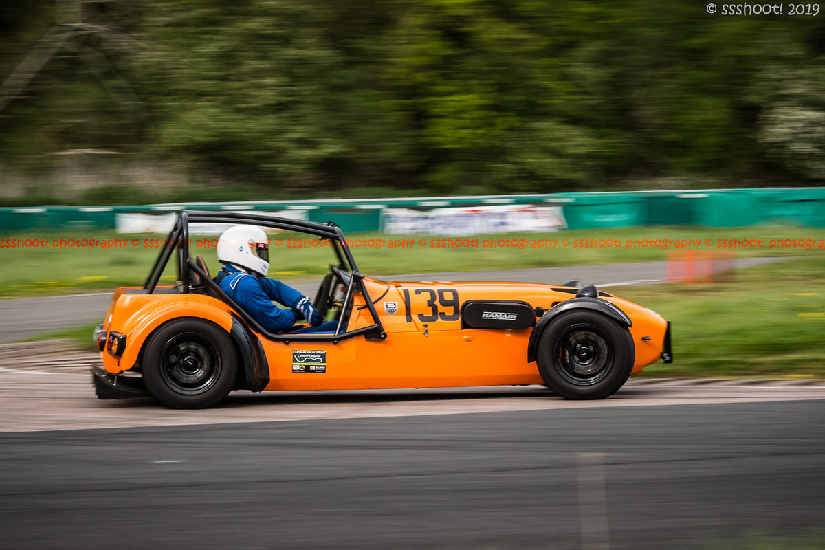 orange lotus 7 caterham westfield at speed on curborough shenstone straight
