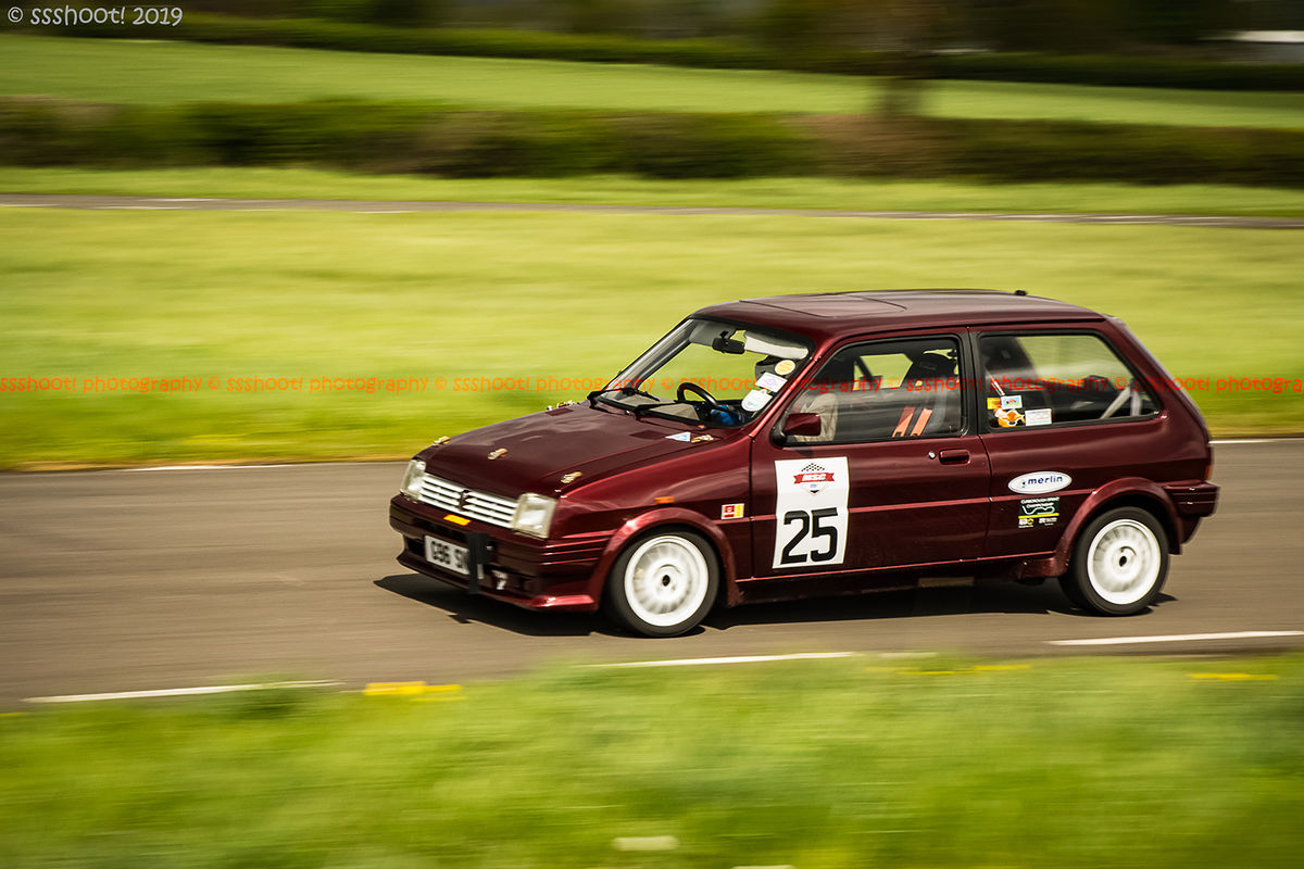 maroon mg metro at speed on curborough shenstone straight