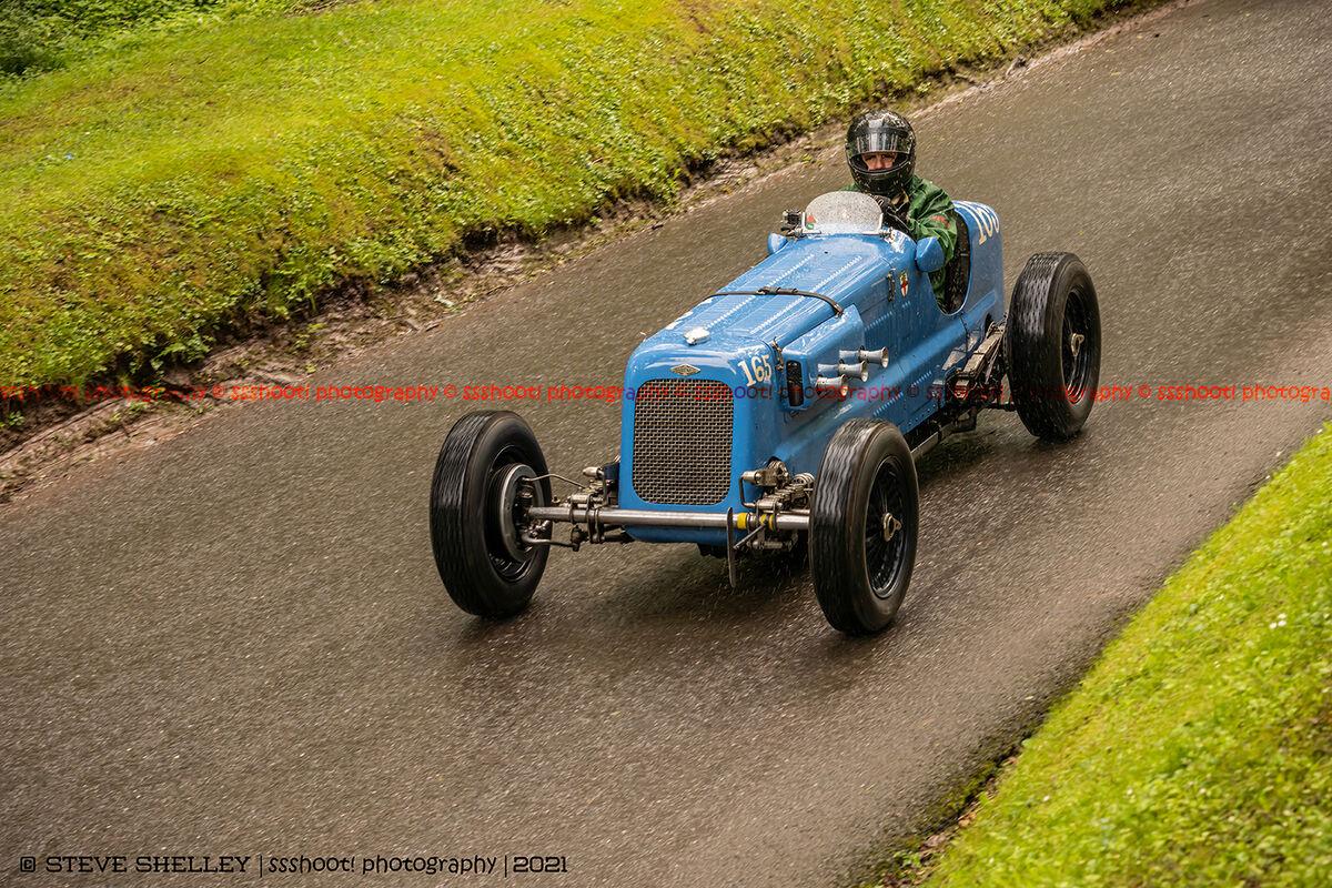 blue fraser nash vintage sports car at the shelsley walsh VSCC event