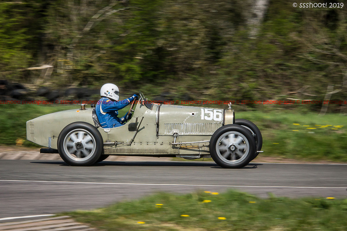 pale green vintage bugatti on curborough track at speed