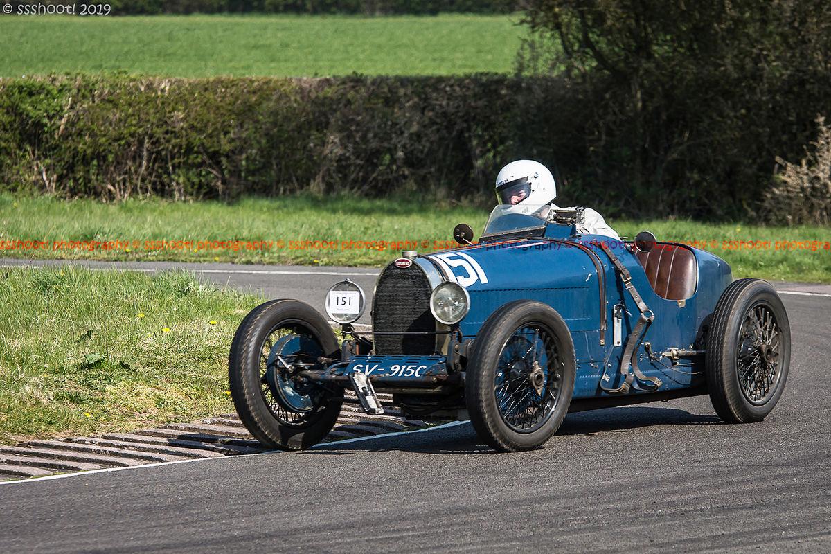 Blue bugatti vintage racing car at speed on curborough sprint course