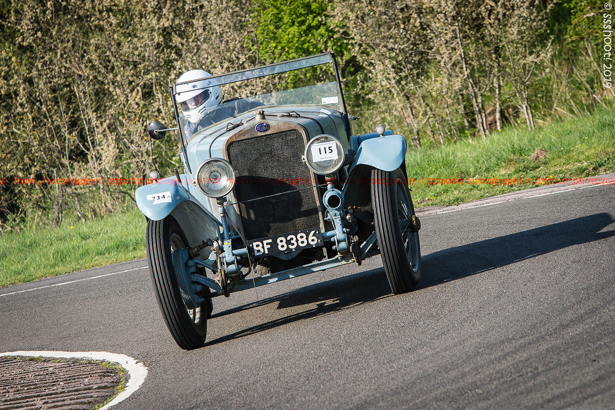 light blue Delage vintage racing car at speed on curborough sprint course
