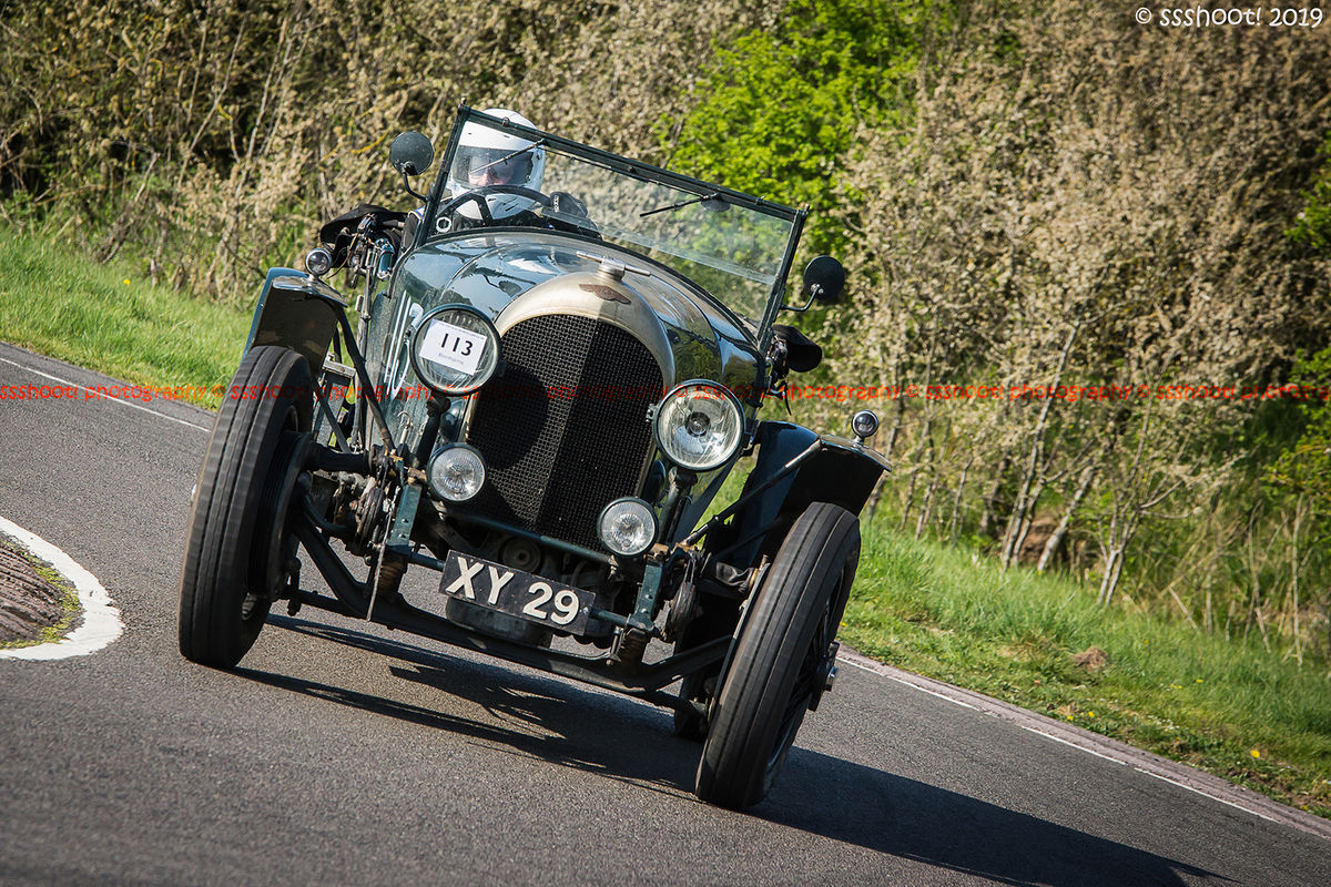 green bentley vintage racing car at speed on curborough sprint course