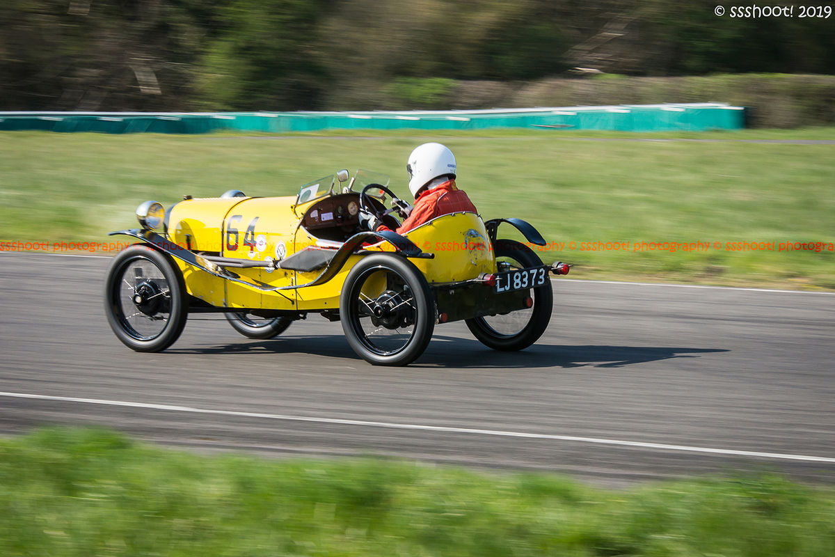 yellow vintage racing car at speed on curborough sprint course
