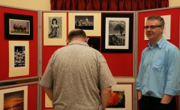 Alba members review prints on display