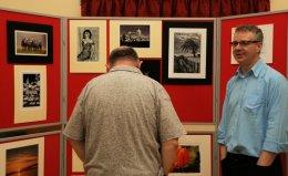 Alba members review prints on display
