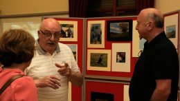 Alba members discuss photography with visitor