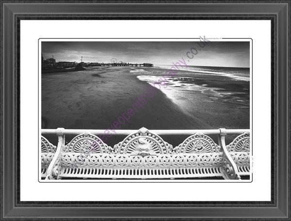 A mono view of Blackpool beach.