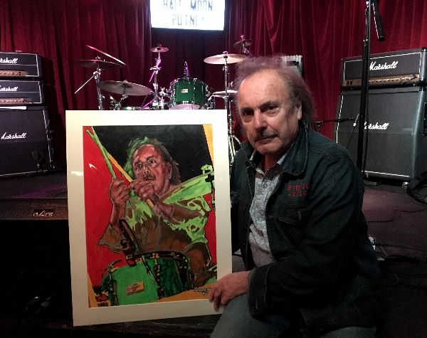 Musician John Coghlan of John Coghlan's Quo with portrait drawing by Stella Tooth
