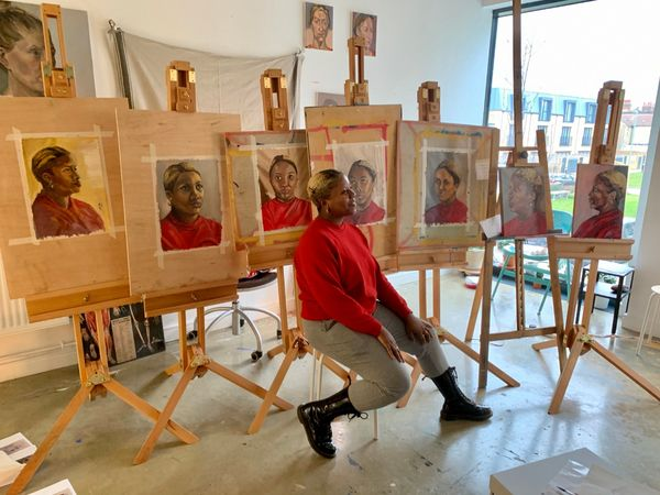 Sketchout portrait in oils course model with student portraits