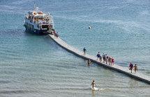 Boarding the Ferry at Agios Nicholas Beach. (a).
