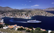Cruise Ship leaving Symi Harbour.