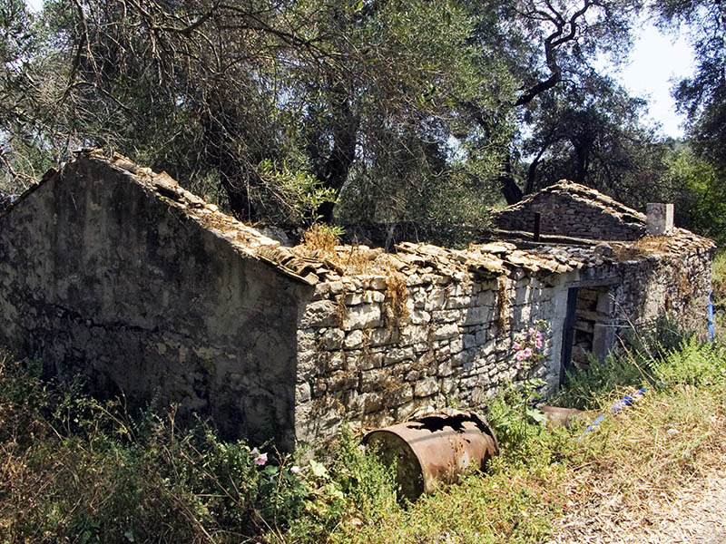 Derelict Olive Press building in Lakka