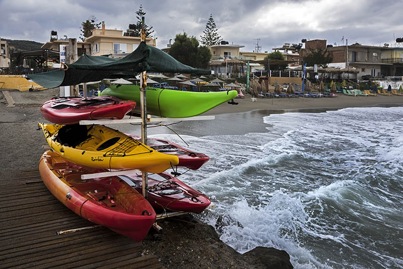 Kayak hire on blustery day at Agia Marina Beach